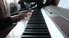 Little girl playing piano for music school - stock footage