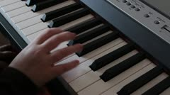 Little girl playing piano for music school Stock Footage