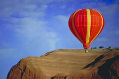 hot air balloon, red rock, new mexico - stock photo