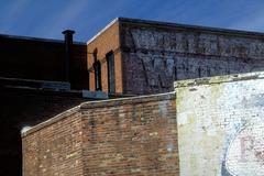 Contrasting brick walls Stock Photos
