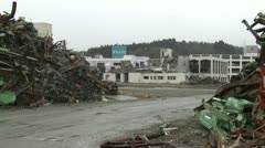 Japan Tsunami 1 Year On - Massive Pile Of Tsunami Debris - stock footage