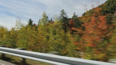 Driving the Kanc Highway in Autumn (side view) - stock footage