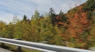 Stock Video Footage of Driving the Kanc Highway in Autumn (side view)