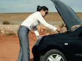 Angry businesswoman by the broken car, outdoors Stock Footage