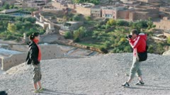 Young couple taking photo in the historical ruins, outdoors Stock Footage