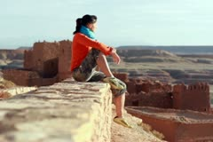 Happy woman sightseeing ancient walls Stock Footage