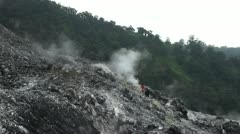 Tourists on the volcanic geysers. Java. Indonesia. Stock Footage