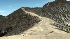 Porters on the volcano Ijen with heavy baskets of sulfur. Stock Footage