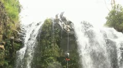 Footage of a person rappelling a waterfall Locked down, long shot in Ecuadorian Stock Footage