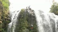 Stock Video Footage of waterfall rappelling