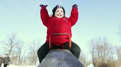 Happy boy on a teeter Stock Footage