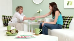 Therapist greets client and begins counselling session. - stock footage
