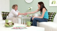 Stock Video Footage of Therapist greets client and begins counselling session.