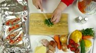 Stock Video Footage of Cooking Baked Fish - Chopping Parsley