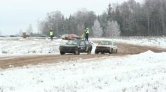 Cars racing on track in winter, rallycross Stock Footage