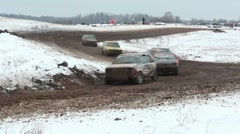Cars racing on track in winter, rallycross Stock Footage