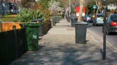 Stock Video Footage of refuse wheelie bins in a london street