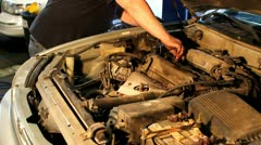 Replacing oil cap on engine Stock Footage
