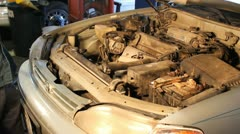 Mechanic shutting a car hood Stock Footage
