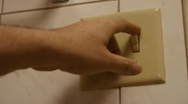 Flipping light switch Stock Footage