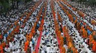 Stock Video Footage of Mass Alms Giving in Bangkok
