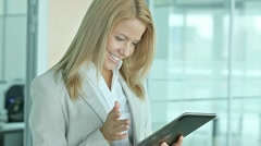 Business lady with pad Stock Footage