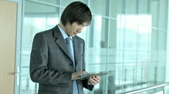 Business guy with tablet-pc - stock footage