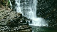 Beautiful waterfall falling on black rock, Carpathians. Stock Footage