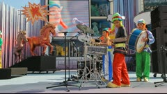 Kids with costumes and drums sing during the Murga competition of the carnival Stock Footage