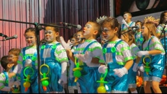 Kids with pacifier costume sing during the Murga competition of the carnival Stock Footage