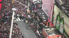 Stock Video Footage of New York City crowds greeting the New Year 2012 in Times Square