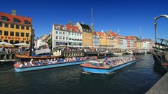 Nyhavn Canal with Tour Boats Passing, Copenhagen GFHD - stock footage