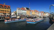Nyhavn Canal with Tour Boats Passing, Copenhagen GFHD Stock Footage