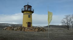 Lighthouse with flag waving in wind 9874 Stock Footage