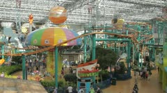 Stock Footage - Wide shot - Mall of America Park - Busy - People - lots of rides Stock Footage