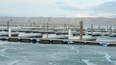 Frozen ice at abbandoned boat dock 9890 Stock Footage