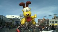 Stock Video Footage of Giant Odie balloon at parade