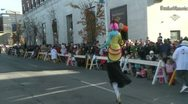 Stock Video Footage of Clown on stilts during parade