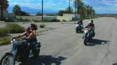 3 Motorcycles Toward Camera On Old Desert Road 1 Stock Footage