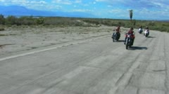 4 Motorcycles Toward Camera On Old Desert Road 1 Stock Footage