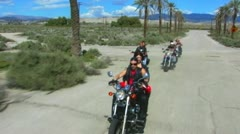 4 Motorcycles Toward Camera On Old Desert Road 3 Stock Footage
