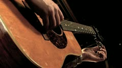 Tuning an Acoustic Guitar HD - stock footage