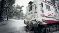 Tracked Rescuing Vehicle in snow storm Stock Footage