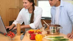 Camera rises to show a couple cooking together Stock Footage