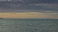 Man paddling on ocean Stock Footage