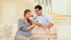 Man offering a rose to his fiancee Stock Footage