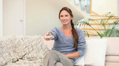 Woman using a remote control Stock Footage