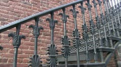Brick wall, ornate ironwork Stock Footage