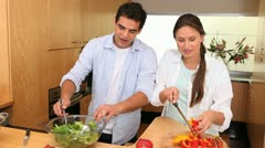 Couple preparing a salad with peppers Stock Footage