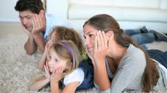 Family lying on front Stock Footage
